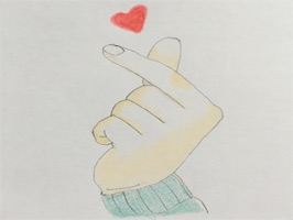 Heart Shaker was drawn on the paper with colored pencils。